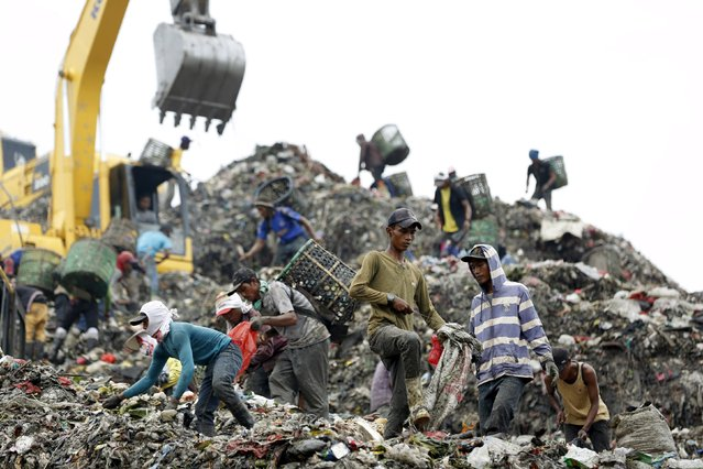 People search through garbage looking for material to recycle at Bantar Gebang, a landfill that takes in thousands of tonnes of waste everyday from Jakarta's more than 10 million residents, in Bekasi, West Java province March 2, 2016. (Photo by Darren Whiteside/Reuters)