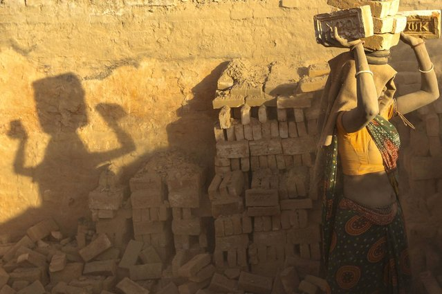 Even young girls are forced to work in the brick factories. (Photo by Narendra Shrestha/EPA)