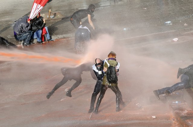 Riot police use tear gas and water canon to disperse protesters as they try to march to the parliament during a protest against Turkey's ruling Ak Party (AKP) and Prime Minister Tayyip Erdogan in Ankara February 13, 2014. (Photo by Umit Bektas/Reuters)