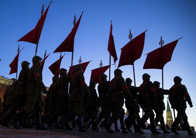 Russian troops march through the Red Square during a rehearsal for the Victory Day military parade which will take place at Moscow's Red Square on May 9 to celebrate 70 years of the victory in WWII, in Moscow, Russia, Monday, May 4, 2015. (Photo by Pavel Golovkin/AP Photo)