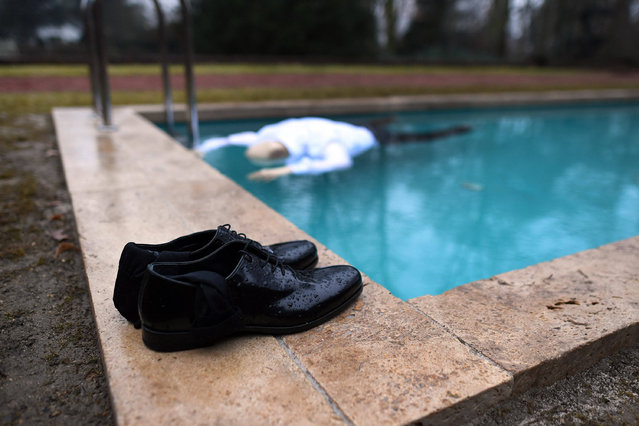 "A puppet representing the former houseowner lies face down in a swimming pool in the Mies van der Rohe- designed Haus Lange in Krefeld, Germany, 17 February 2017. Scandinavian artist duo Michael Elmgreen (Denmark) and Ingar Dragset (Norway) have been given the run of the house for an art installation that takes up the topic Britain' s decision to leave the European Union known as ""Brexit"". The piece centres on a German family leaving Britain and returning to Germany in the wake of the referendum. (Photo by Federico Gambarini/DPA)"