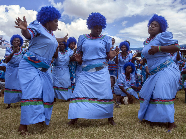 Supporters of Malawi's Democratic Progressive Party's (DPP) ruling party dance during the official launch of its manifesto and election campaign on April 7, 2019, at Kamuzu Institute for Sports in Malawi's capital Lilongwe, ahead of next month's elections. Mutharika, who has been in power since 2014, will face tough opposition, including from his own deputy Saulos Chilima, at the May 21 election. (Photo by Amos Gumulira/AFP Photo)