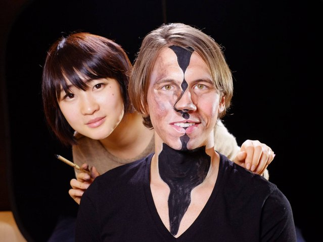 Tokyo-based artist Hikaru Cho with one of her models. (Photo by Jim Marks/PA Wire)