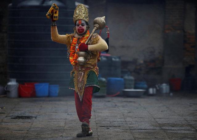 A Hindu holy man, or sadhu, walks along the premises of Pashupatinath Temple, ahead of the Shivaratri festival in Kathmandu, Nepal February 21, 2017. (Photo by Navesh Chitrakar/Reuters)