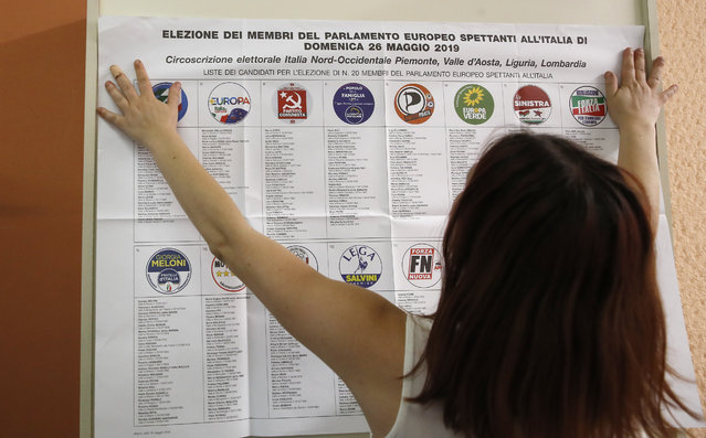 List of candidates are placed in a polling station ahead of Sunday's European Elections, in Rozzano, near Milan, Italy, Saturday, May 25, 2019. Some 400 million Europeans from 28 countries head to the polls from Thursday to Sunday to choose their representatives at the European Parliament for the next five years. (Photo by Antonio Calanni/AP Photo)