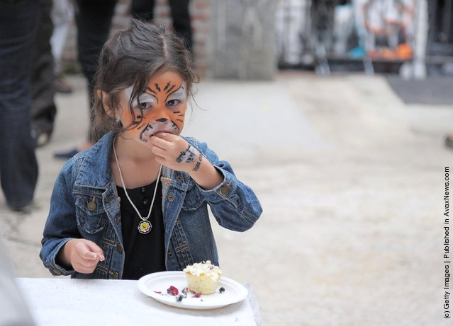 A young girl indulges in a bite to eat during the City Harvest Presents The Brooklyn Local at Tobacco Warehouse