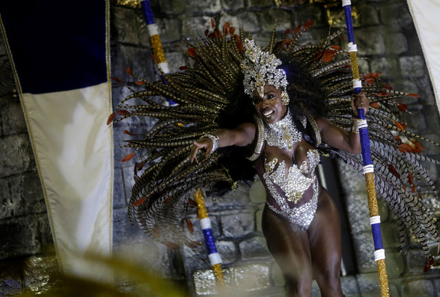 A reveller from Sao Clemente samba school performs during the second night of the carnival parade at the Sambadrome in Rio de Janeiro, Brazil February 28, 2017. (Photo by Ricardo Moraes/Reuters)