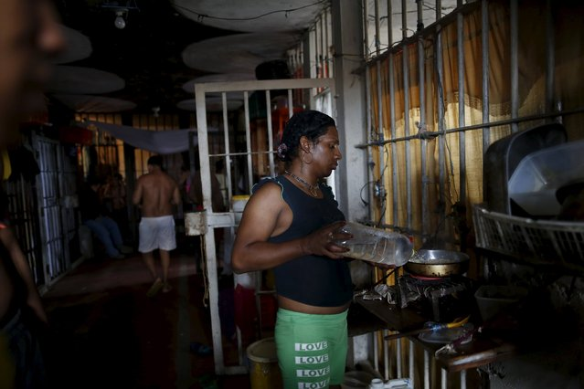 Inmate Miguel Lopez, who is HIV positive, cooks in the transgender gallery in La Joya prison on the outskirts of Panama City, Panama January 27, 2016. (Photo by Carlos Jasso/Reuters)
