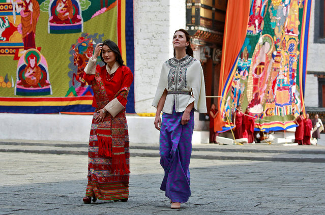 Britain's Catherine, Duchess of Cambridge is shown around the Tashichho Dzong temple by Queen Jetsun Pema Wangchuck in Thimphu, Bhutan, April 14, 2016. (Photo by Cathal McNaughton/Reuters)