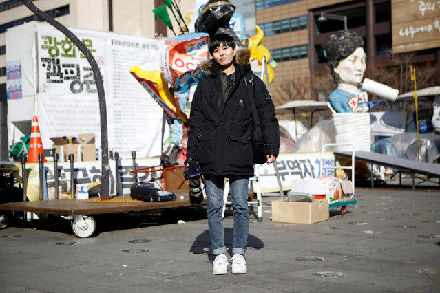 """Jeung Un, 27, a freelance photographer, poses for a portrait at a site which protesters have occupied, in central Seoul, South Korea, February 23, 2017. """"Most news outlets prefer to employ male photographers. I feel strongly about gender inequality. When I cover violent scenes, sometimes I am harassed and hear sexually-biased remarks"""", Un said. (Photo by Kim Hong-Ji/Reuters)"""