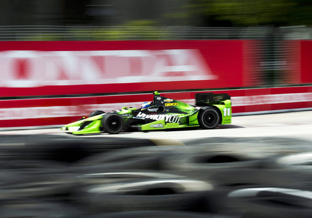 Sebastien Bourdais, of Colombia, makes a corner during practice for the IndyCar auto race Saturday, June 13, 2015, in Toronto. (Nathan Denette/The Canadian Press via AP)