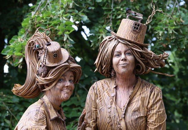 "Artist called ""Wooden Statues"" takes part in the festival ""Statues en Marche"" in Marche-en-Famenne, Belgium, July 20, 2019. (Photo by Yves Herman/Reuters)"