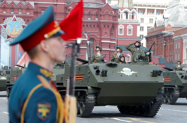 Russian servicemen drive BTR-MDM Rakushka (Shell) airborne armored personnel carriers along Red Square during a rehearsal for the Victory Day parade, marking the 71st anniversary of the victory over Nazi Germany in World War Two, in central Moscow, Russia, May 7, 2016. (Photo by Sergei Karpukhin/Reuters)