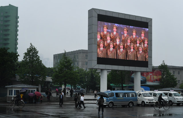 A large screen monitor with patriotic messages  in Pyongyang, North Korea on May 6, 2016. (Photo by Linda Davidson/The Washington Post)