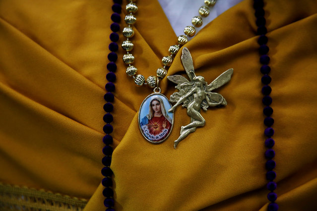 """Maya"" assistant girl Lara Ibarra, 12, wears a medallion of the Virgin during ""Las Mayas"" festivity in Madrid, Spain, May 8, 2016. (Photo by Susana Vera/Reuters)"
