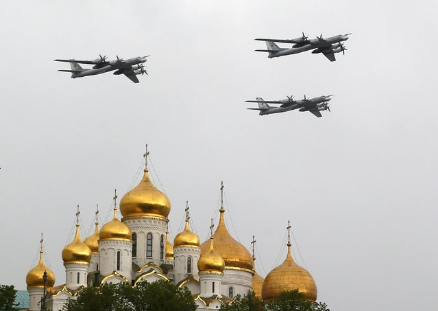 Russian Air Force strategic bombers, Tu-95, fly over Red Square in Moscow, Russia, 07 May 2014, during a general rehearsal for the military parade which will take place on Red Square on 09 May, to commemorate the victory of the Soviet Union's Red Army over Nazi-Germany in WWII. (Photo by Yuri Kochetkov/EPA)