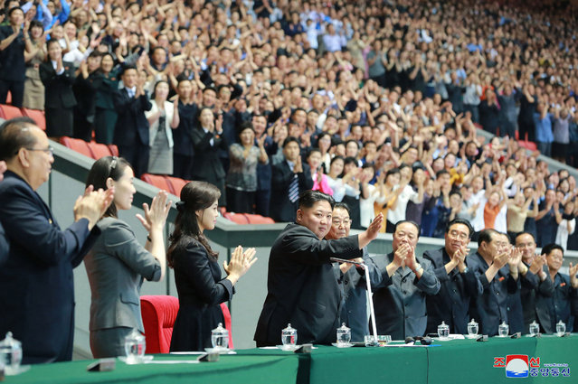 """In this Monday, June 3, 2019, photo provided on Tuesday, June 4, 2019, by the North Korean government, North Korean leader Kim Jong Un, center, waves with his wife Ri Sol Ju, center left, during the grand gymnastics and artistic performance at the May Day Stadium in Pyongyang. The woman next to Ri Sol Ju appears to be Kim's sister, Kim Yo Jong, who state media said attended the performance. Independent journalists were not given access to cover the event depicted in this image distributed by the North Korean government. The content of this image is as provided and cannot be independently verified. Korean language watermark on image as provided by source reads: """"KCNA"""" which is the abbreviation for Korean Central News Agency. (Photo by Korean Central News Agency/Korea News Service via AP Photo)"""