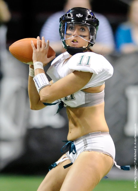 Quarterback Christy Bell #11 of the Philadelphia Passion looks to pass against the Los Angeles Temptation during the Lingerie Football League's Lingerie Bowl IX