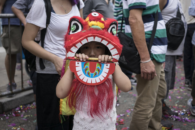 A child wearing his dragon costume during the Buddha's Birthday festival in Shau Kei Wan, Hong Kong, on May 3, 2017. Buddha's Birthday is a festival traditionally celebrated the Buddhism. People dressed up with traditional costumes and danced with the dragon. (Photo by Chan Long Hei/Pacific Press/LightRocket via Getty Images)