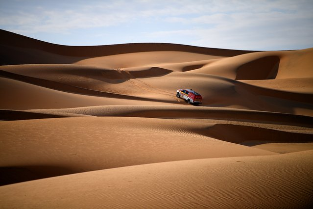 Dakar rally manager of the road book Pablo Eli and sports coordinator Edo Mossi drive on October 18, 2019 in Saudi Arabia during the recce for the next Dakar 2020 that will kick off on January 5 in Jeddah and will run untill January 17. (Photo by Franck Fife/AFP Photo)
