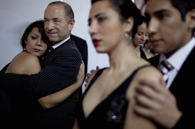 Italy's dancers Eloina Martins, left, and Paolo Nelzi, second from left, among others, wait before competing during the 2012 Tango Dance World Cup in Buenos Aires, Argentina, Monday, August 20, 2012. (Photo by Natacha Pisarenko/AP Photo)