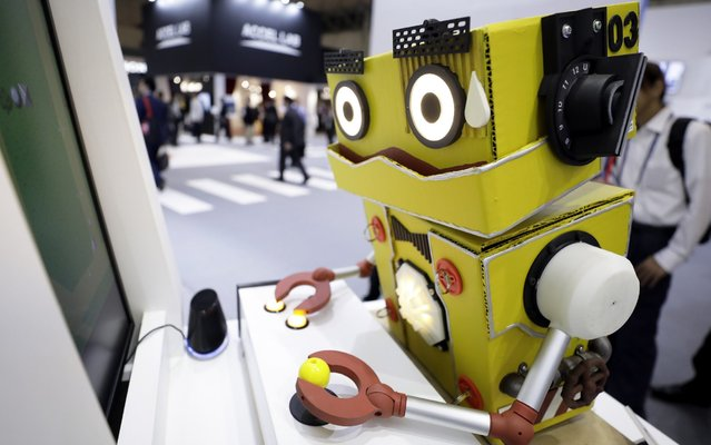 "An AI Gamer ""Q56"" robot plays a video game during a demonstration at the Bandai Namco Holdings Inc. booth at the Combined Exhibition of Advanced Technologies in Chiba, Japan on October 16, 2019. (Photo by Kiyoshi Ota/Bloomberg)"