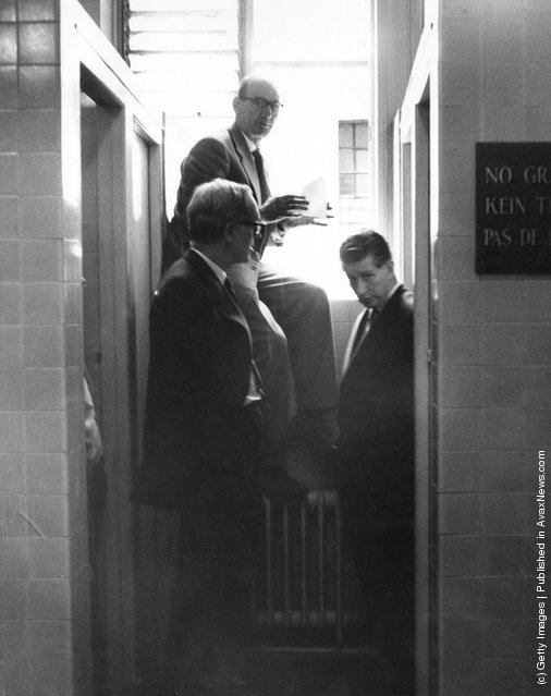 Scotland Yard detectives search a men's toilet for evidence during a search of the National Gallery after the theft of Francisco Goya's painting 'Portrait of the Duke of Wellington', London, 23rd August 1961. The thief is believed to have escaped via the window. The painting was returned in 1965 and retired bus driver Kempton Bunton was later convicted of the theft of the frame