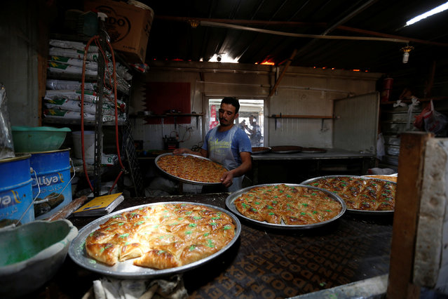 A Syrian refugee makes sweets for sale at the Al-Zaatari refugee camp in Mafraq, Jordan, near the border with Syria May 30, 2016. (Photo by Muhammad Hamed/Reuters)