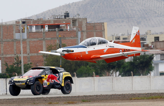 PH Sport's driver Sebastian Loeb races against an airplane during a performance act at the Peru Dakar Rally in Lima, Peru on January 5, 2019. (Photo by Carlos Jasso/Reuters)