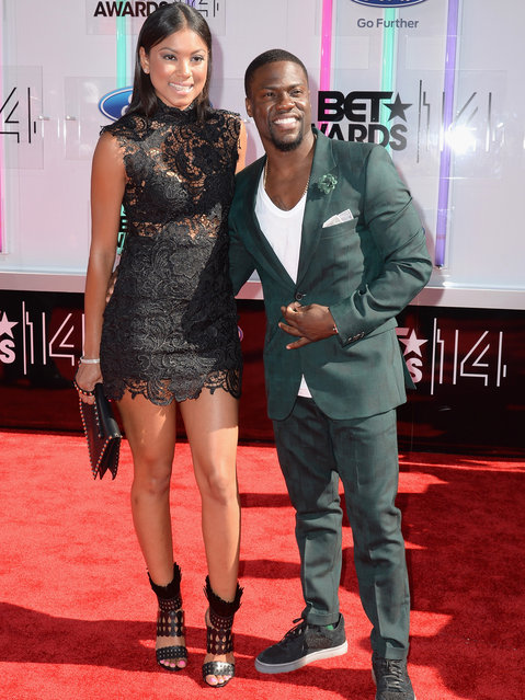 Actor Kevin Hart (R) and Eniko Parrish attend the BET AWARDS '14 at Nokia Theatre L.A. LIVE on June 29, 2014 in Los Angeles, California. (Photo by Earl Gibson III/Getty Images for BET)