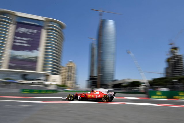 Ferrari's German driver Sebastian Vettel steers his car during the first practice session of the Formula One Azerbaijan Grand Prix at the Baku City Circuit on June 23, 2017. (Photo by Andrej Isakovic/AFP Photo)