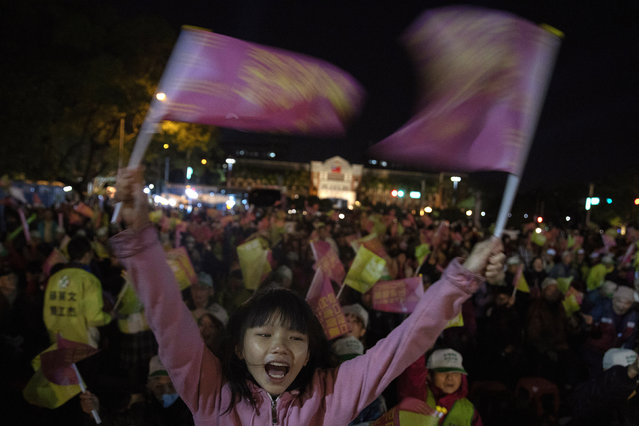 In this Wednesday, January 8, 2020, photo, supporters of Tsai Ing-wen, Taiwan's President and the 2020 presidential election candidate for the Democratic Progressive Party (DPP), cheer during an election campaign rally in northern Taiwan's Hsinchu province. A year ago, the Taiwan leader was on the ropes. Now President Tsai appears poised to win a second four-year term in elections this Saturday. (Photo by Ng Han Guan/AP Photo)