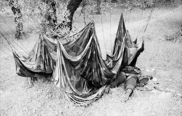 A fallen paratrooper and his parachute, on the island of Crete, in early 1941