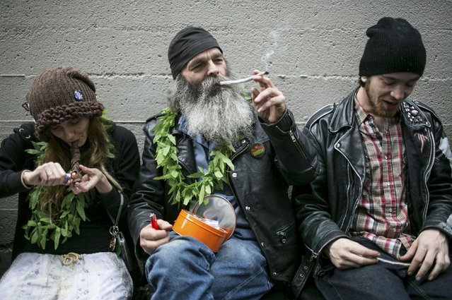 Hu Barney (C), smokes a joint during 420Fest at the Luxe Nightclub in Seattle, Washington in this file photo April 20, 2013. The Obama administration has decided not to sue Colorado and Washington over new laws that legalized recreational marijuana, allowing the two states to carry on their experiment as long as they follow new federal guidelines, a U.S. Justice Department official said on Thursday. (Photo by Nick Adams/Reuters)