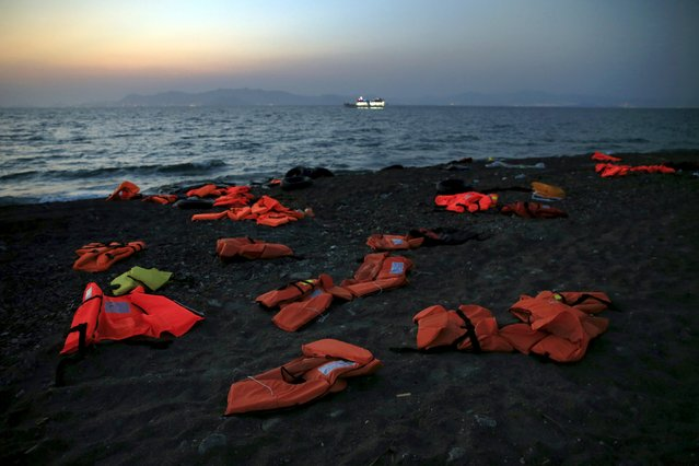 Lifejackets are seen abandoned by Syrian refugees on a beach after they crossed the Aegean Sea in a dinghy from Turkey to the Greek island of Kos, August 8, 2015. (Photo by Yannis Behrakis/Reuters)
