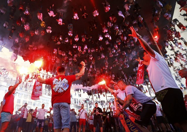 Football Soccer, EURO 2016, Marseille, France on June 21, 2016. Poland fans are reflected in a mirrored ceiling as they wave flares at the old port of Marseille, France.      REUTERS/Wolfgang Rattay     TPX IMAGES OF THE DAY