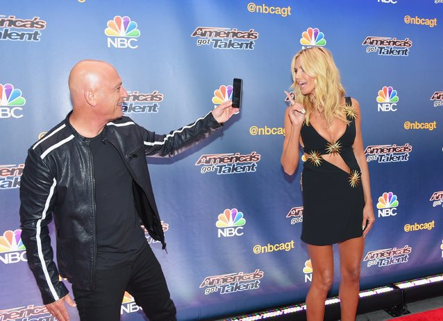 "Comedian/TV personality Howie Mandel takes a picture of model/TV personality Heidi Klum before the ""America's Got Talent"" season 10 taping at Radio City Music Hall on August 11, 2015 in New York City. (Photo by Michael Loccisano/Getty Images)"