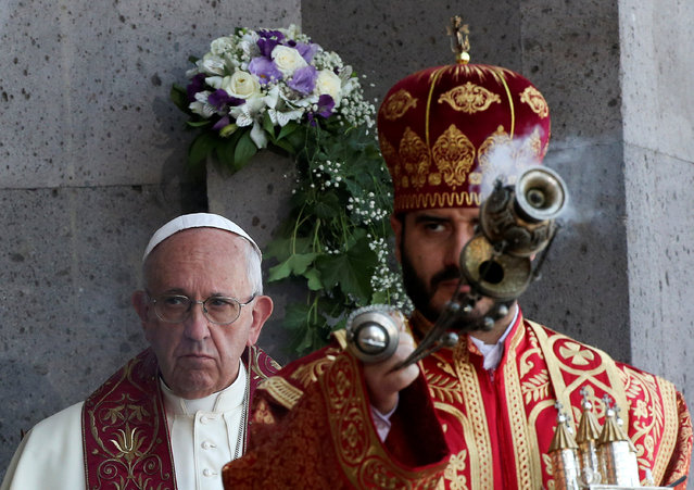 Pope Francis (L) looks on as a member of the Armenian Church (R) burns incense during the Divine Liturgy at the Armenian Cathedral in Etchmiadzin, Armenia, June 26, 2016. (Photo by Alessandro Bianchi/Reuters)