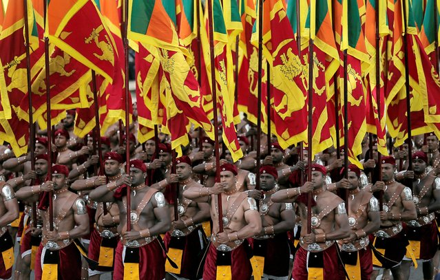 Sri Lanka's military march with national flags during the 72nd independence day ceremony, in Colombo, Sri Lanka on February 4, 2020. (Photo by Dinuka Liyanawatte/Reuters)