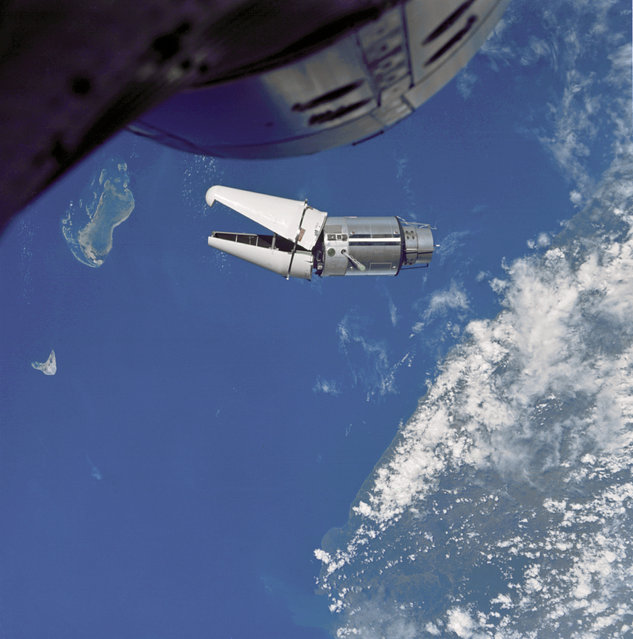 """The Augmented Target Docking Adapter (ATDA) as seen from the Gemini 9 spacecraft during one of their three rendezvous in space. The ATDA and Gemini 9 spacecraft are 66.5 ft. apart. Failure of the docking adapter protective cover to fully separate on the ATDA prevented the docking of the two spacecraft. The ATDA was described by the Gemini 9 crew as an """"angry alligator"""". (Photo by NASA)"""