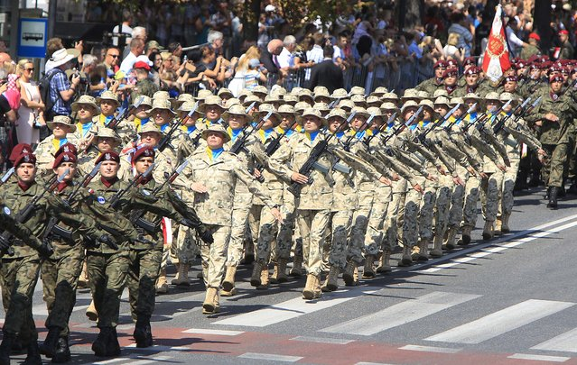 Polish Army soldiers march during a military parade celebrating the Polish Army Day in Warsaw, Poland, Saturday, August 15, 2015. (Photo by Czarek Sokolowski/AP Photo)
