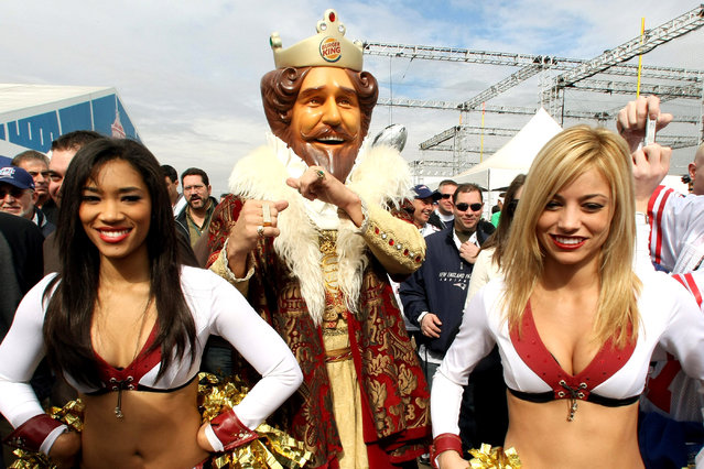 The Burger King mascot  stands outside the stadium prior to the kickoff of Super Bowl XLII between the New York Giants and the New England Patriots at the University of Phoenix Stadium in Glendale, Arizona 03 February 2008. (Photo by Timothy A. Clary/AFP Photo)