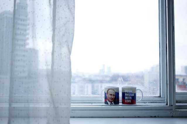 Mugs with a picture of Russian President Vladimir Putin are seen in this photo illustration taken in a hotel room in Kazan, Russia, July 31, 2015. (Photo by Stefan Wermuth/Reuters)