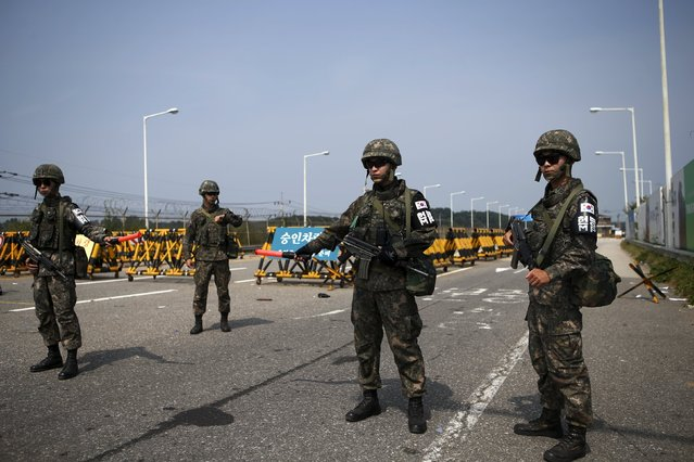 South Korean soldiers stand guard at a checkpoint on the Grand Unification Bridge which leads to the truce village Panmunjom, just south of the demilitarized zone separating the two Koreas, in Paju, South Korea, August 24, 2015. (Photo by Kim Hong-Ji/Reuters)