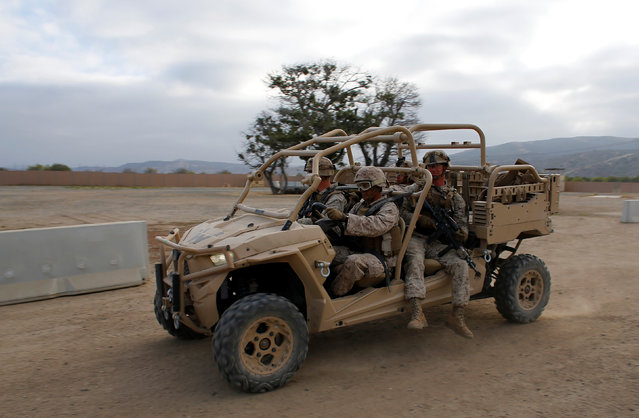 U.S. Marines travel in a Polaris MRZR vehicle during an training session as part of the Rim of the Pacific (RIMPAC) 2016 exercise held at Camp Pendleton, California United States, July 13, 2016. (Photo by Mike Blake/Reuters)
