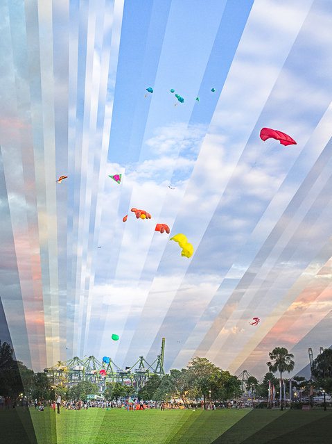 Day turns to night while people fly kites at the Marina Barage in Singapore, 2013. (Photo by Fong Qi Wei/Thoughtful Photography)