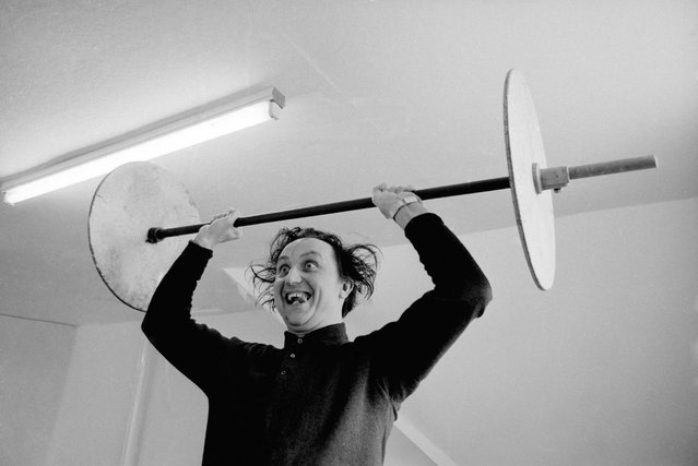 English comedian Ken Dodd lifting weights. 21st April 1966. (Photo by Wood/Express)