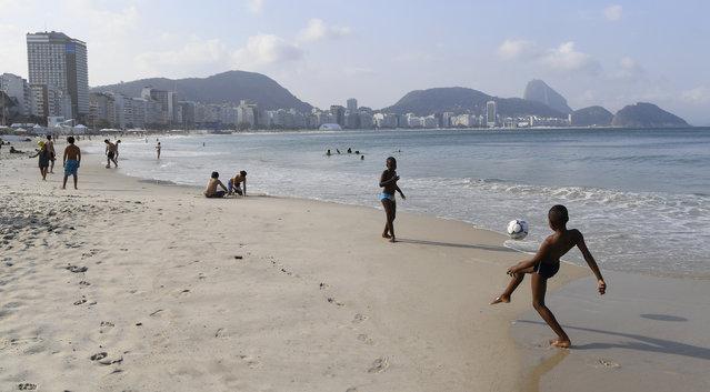 Kids play soccer on Copacabana beach on August 2, 2016 in Rio De Janeiro, Brazil. (Photo by Jonathan Newton/The Washington Post)