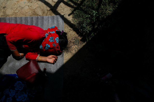 A woman who had been walking for ten hours, sleeps at the floor near the police station after being stopped as she walked to her village during the twenty-sixth day of the lockdown imposed by the government amid concerns about the spread of coronavirus disease (COVID-19) outbreak, in Lalitpur, Nepal on April 18, 2020. (Photo by Navesh Chitrakar/Reuters)