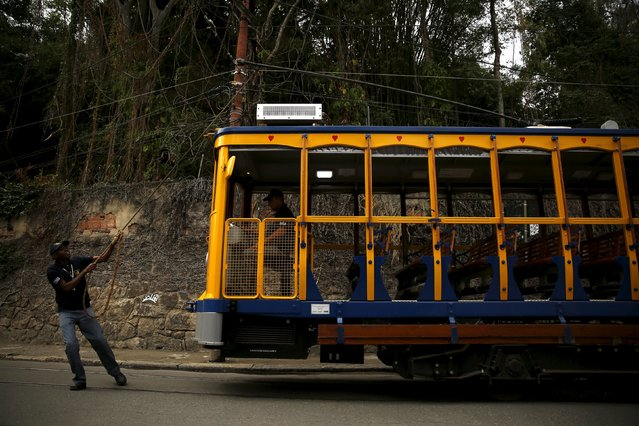 A worker manually changes the direction of the bonde, the typical tram line in Santa Teresa neighborhood, using a rope in Rio de Janeiro, Brazil, September 9, 2015. (Photo by Pilar Olivares/Reuters)